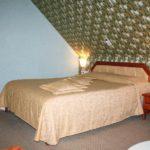 Кровать в номере комфорт